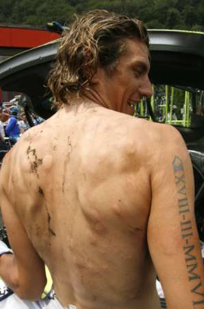 Liquigas's team rider Filippo Pozzato shows hailstone impacts on his shoulders after a storm in Gnosca after the start of the sixth stage of the Tour of  Switzerland cycling race June 21, 2007. The race was stopped and a new start will take place in Ullrichen later on today. REUTERS/Denis Balibouse   (SWITZERLAND)